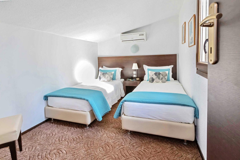 Bedroom 1 single beds