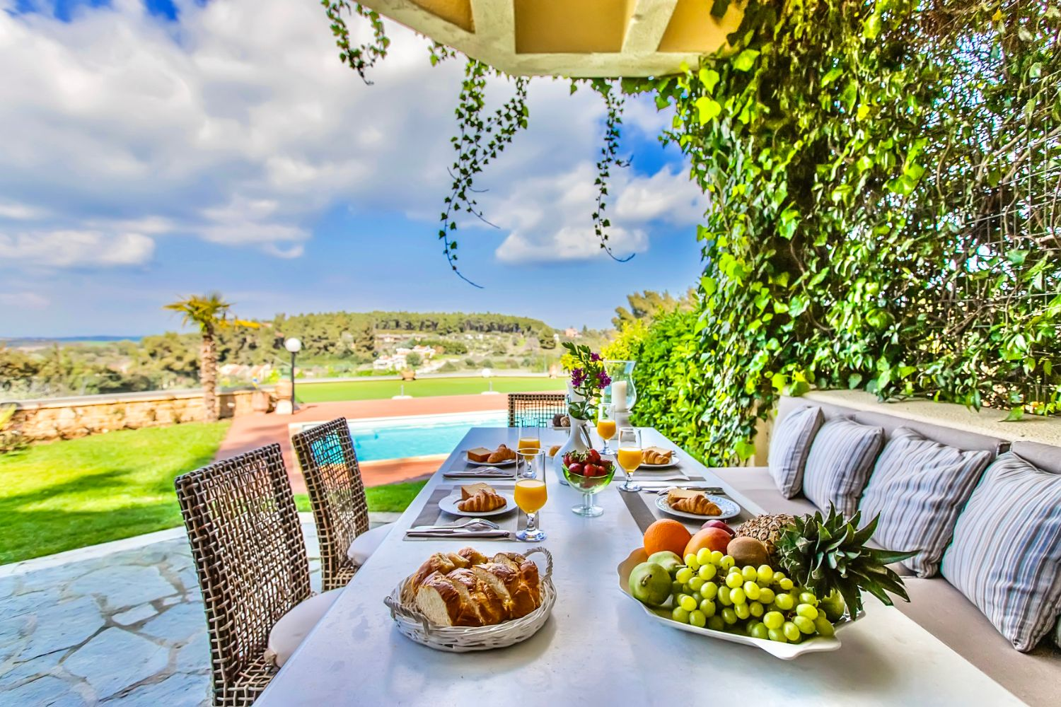 Outdoor dining area with pool view