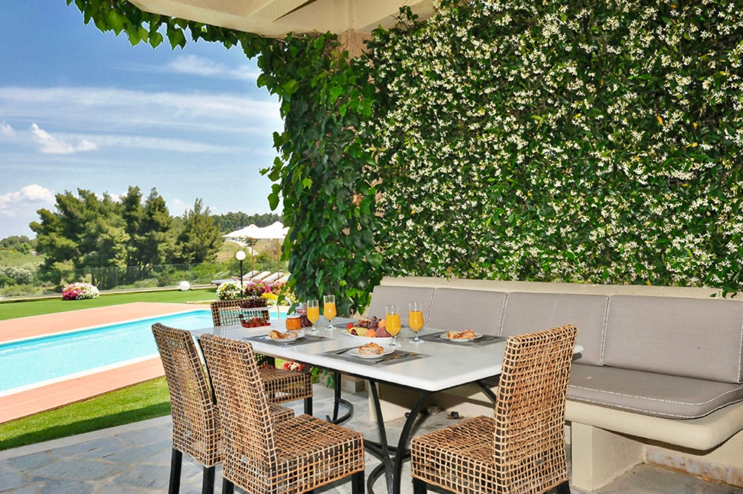 Outdoor dining area and pool view