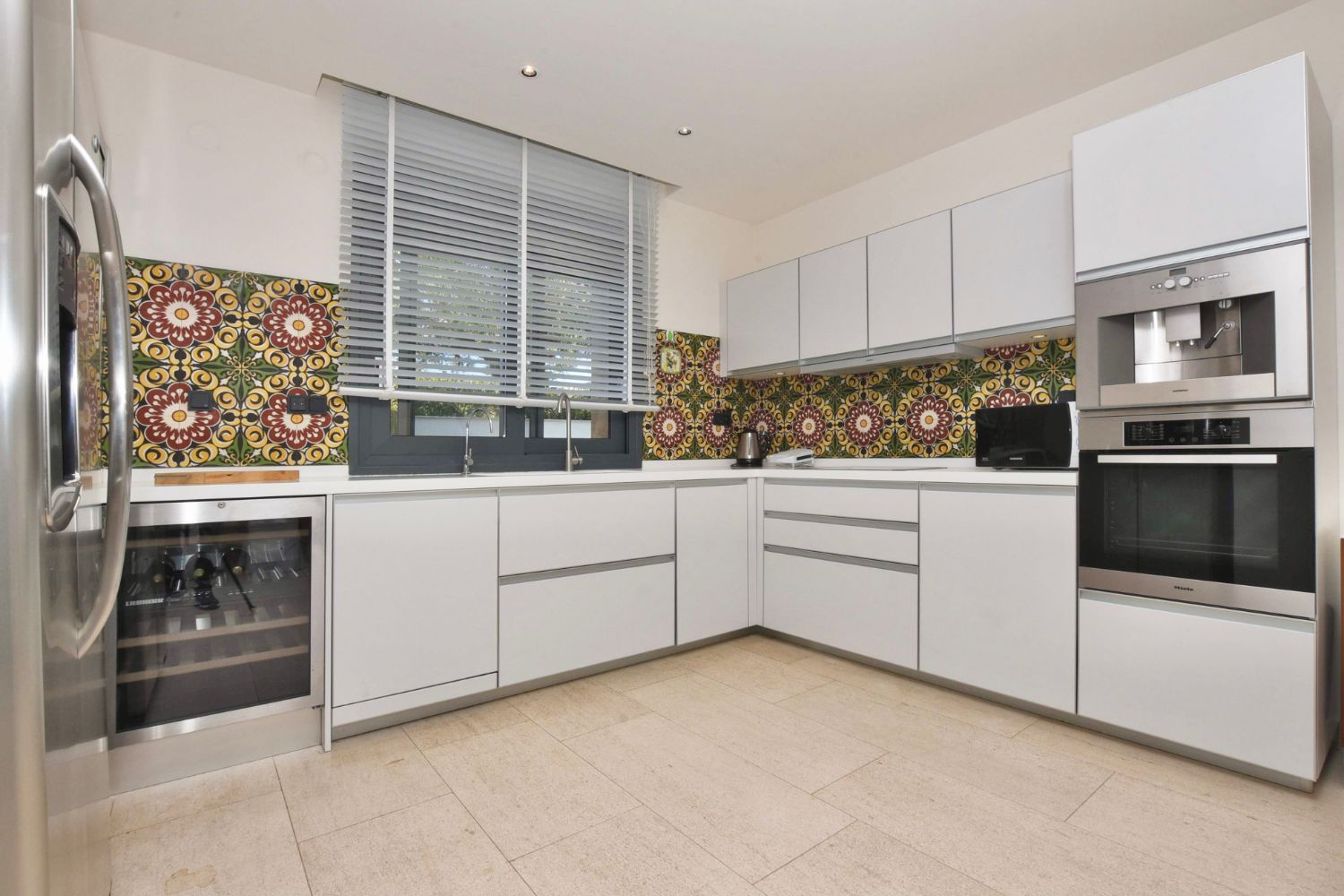 Fully Equipped Kitchen With A Wine Cooler